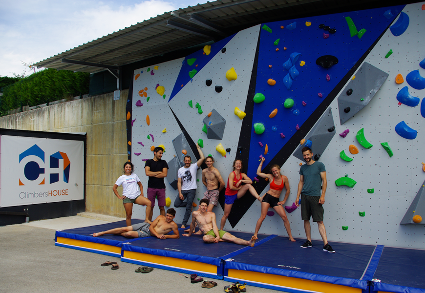 group in front of climbing wall